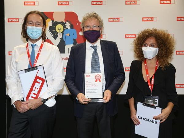Marco Mancini, Scm Group's General Manager, with Pierantonio Macola, Smau's President, and Simona Regina, journalist at Radio Rai.
