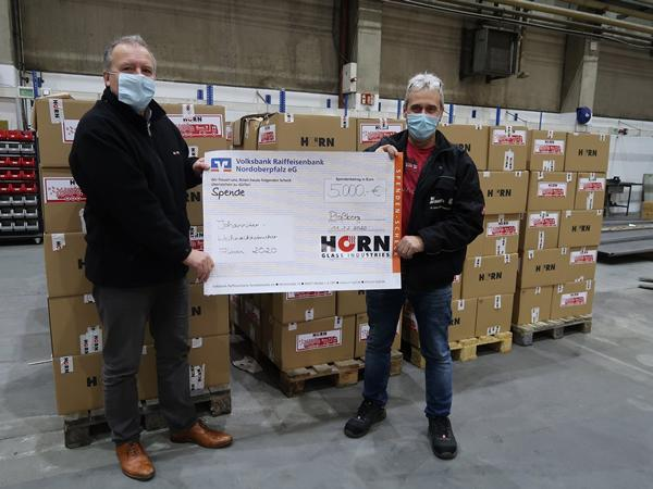 HORN® packs 222 parcels for the Johanniter Christmas trucker campaign